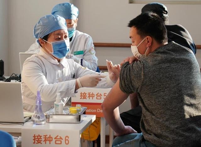 Trung Quốc triển khai chương trình hộ chiếu vắc xin Covid-19 - 1