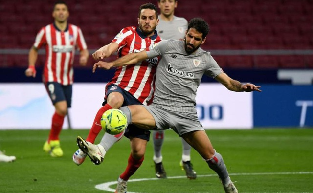 Luis Suarez ghi bàn, Atletico bứt phá trước Barcelona và Real Madrid - 1