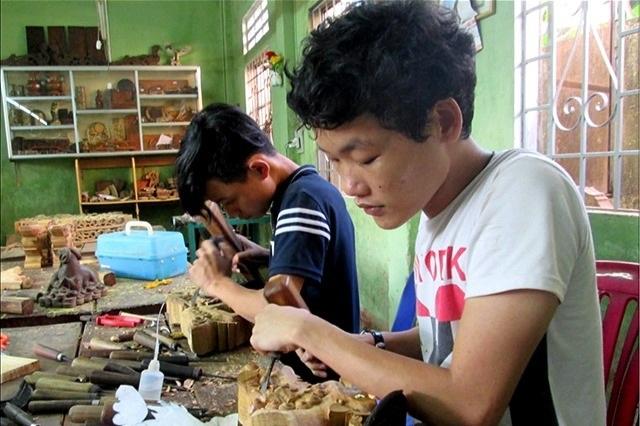 Hỗ trợ đào tạo nghề, việc làm cho 300-500 người khuyết tật - 1