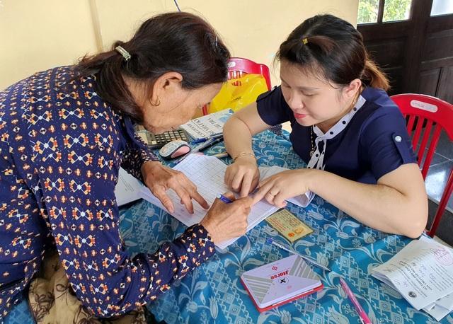 Quảng Nam đẩy mạnh chi trả các chế độ BHXH không dùng tiền mặt - 1
