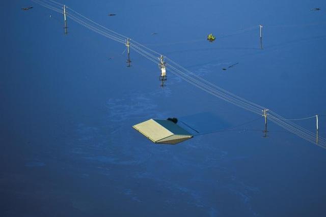 Australia tan hoang trong biển nước vì trận lũ tồi tệ nhất 50 năm qua - 5