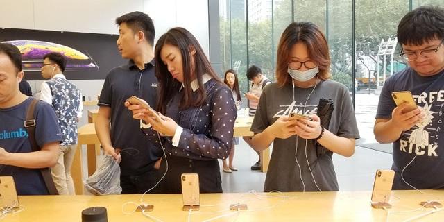 Sử dụng iPhone bị coi là đáng xấu hổ ở Trung Quốc, vì sao vẫn tăng mạnh? - 1