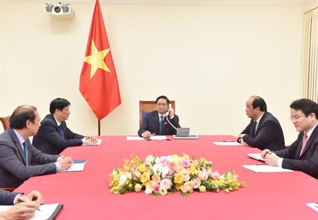 Tân Thủ tướng Phạm Minh Chính điện đàm với Thủ tướng Lào, Campuchia - 1