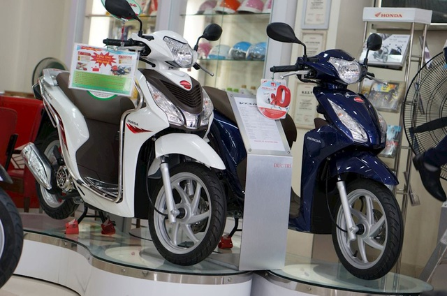 Sức mua xe máy của người Việt đang giảm - 1