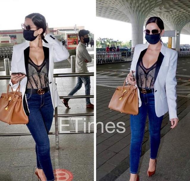 Mặc hở bạo tại sân bay, kiều nữ Nora Fatehi bị thợ săn ảnh Ấn Độ đeo bám - 2