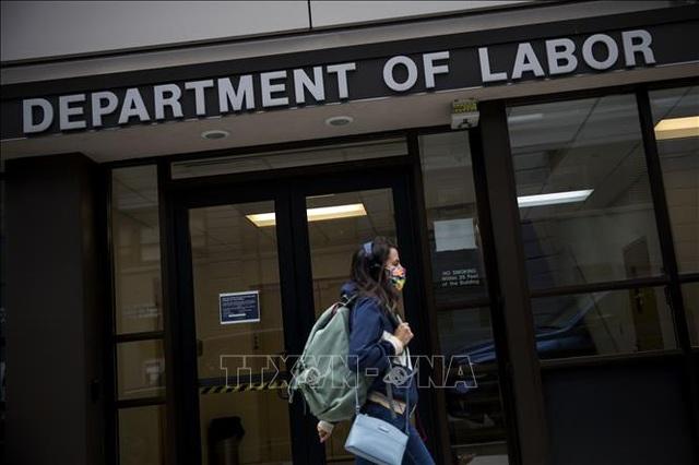 Tổng thống Biden thúc đẩy tăng lương tối thiểu cho người lao động - 1
