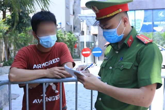 Hà Nội phong tỏa chung cư có nữ nhân viên quán bar dương tính SARS-CoV-2 - 2