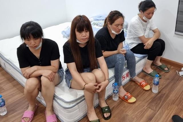 Hà Nội: Cảnh sát phá cửa, bắt quả tang 12 người Trung Quốc nhập cảnh chui - 1