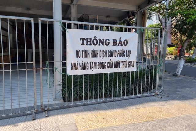 Bãi biển Đà Nẵng vắng người sau lệnh cấm - 6