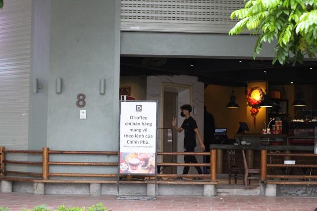 Quán cà phê đặt biển chỉ bán mang về, đóng cửa phòng dịch Covid-19 - 1