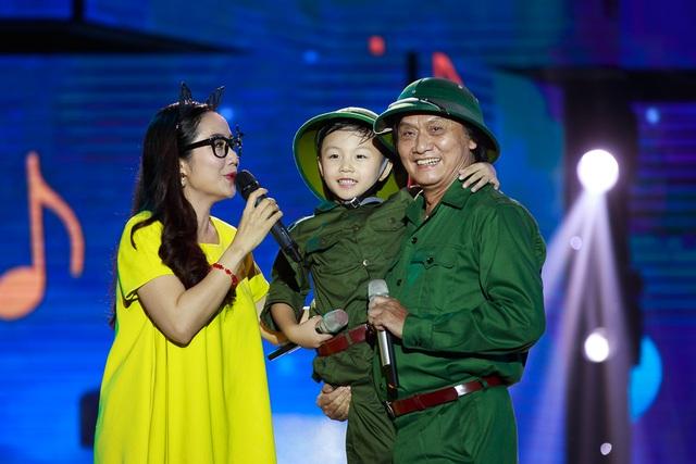 NSƯT Quang Lý và bé Hải Nam - giọng ca nhí Đồ Rê Mí 2014.