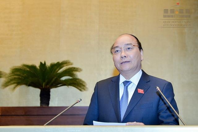 Thủ tướng Nguyễn Xuân Phúc tại phiên trả lời chất vấn trước Quốc hội sáng 17/11.