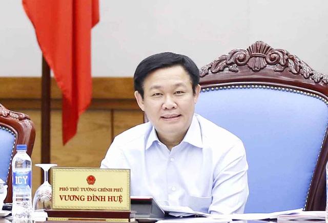Phó Thủ tướng Vương Đình Huệ chủ trì buổi làm việc với các bộ, ngành nhằm tháo gỡ khó khăn vướng mắc cho hoạt động bảo lãnh tín dụng cho các DNNVV (Ảnh: VGP)
