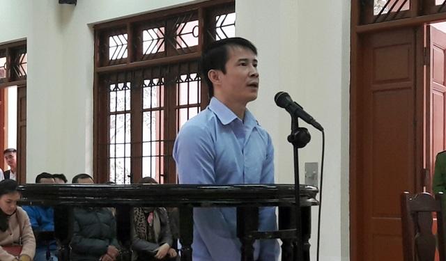 Nguyễn Quang Vinh tại phiên xử sơ thẩm sáng 19/12.