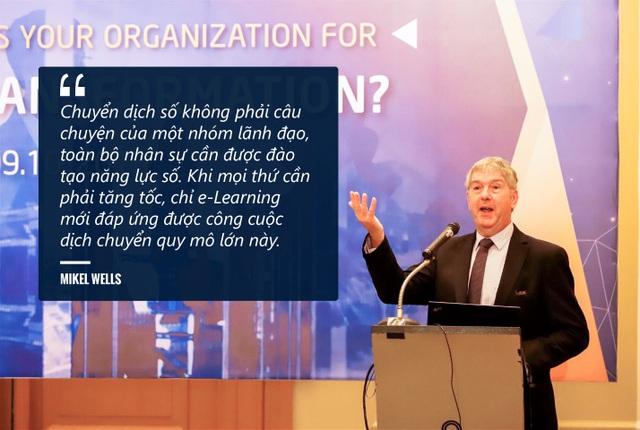 Ông Mike Wells chia sẻ tại hội thảo