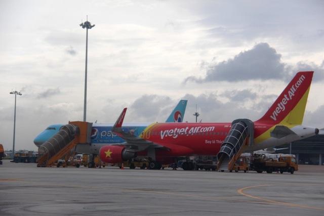 Bí thư Đinh La Thăng cho rằng điều chỉnh giờ bay sẽ giúp giải quyết ùn tắc giao thông tại Tân Sơn Nhất
