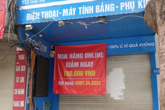 Hà Nội: Cửa hàng điện thoại ngừng kinh doanh, khó khăn nối tiếp khó khăn - 9