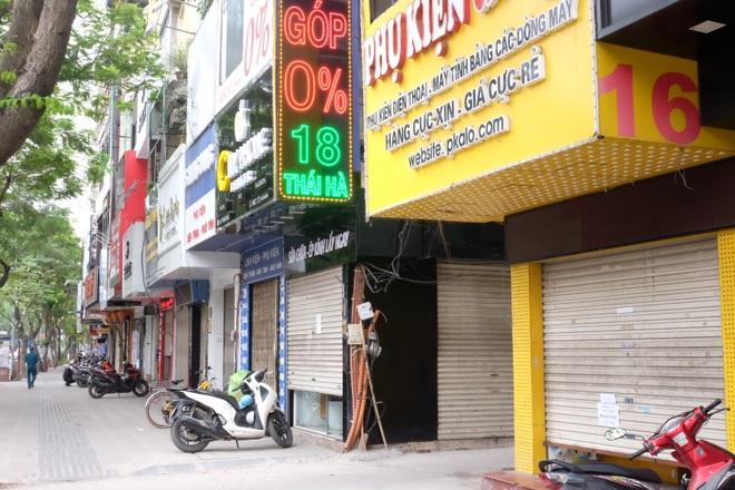 Hà Nội: Cửa hàng điện thoại ngừng kinh doanh, khó khăn nối tiếp khó khăn - 1
