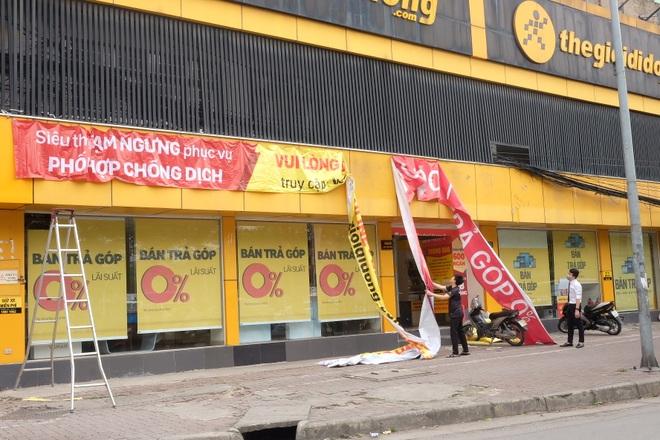 Hà Nội: Cửa hàng điện thoại ngừng kinh doanh, khó khăn nối tiếp khó khăn - 2