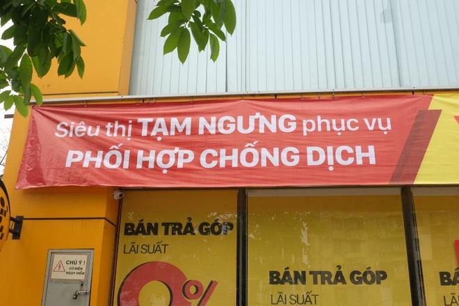 Hà Nội: Cửa hàng điện thoại ngừng kinh doanh, khó khăn nối tiếp khó khăn - 11