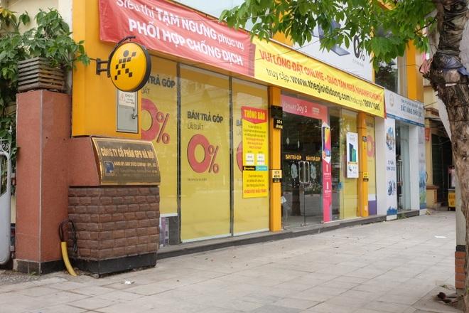 Hà Nội: Cửa hàng điện thoại ngừng kinh doanh, khó khăn nối tiếp khó khăn - 8