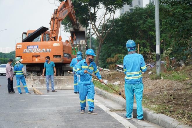 Dọn gần 200 tấn rác thải dọc đại lộ Thăng Long sau phản ánh của báo Dân trí - 8
