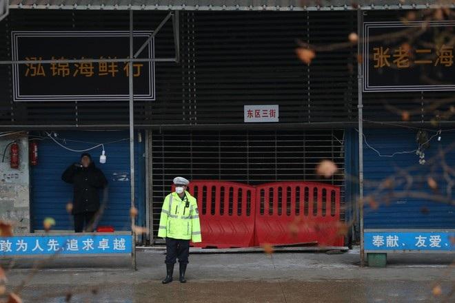 Dịch xuất hiện trở lại ở Vũ Hán sau hơn một năm sạch bóng Covid-19 - 1