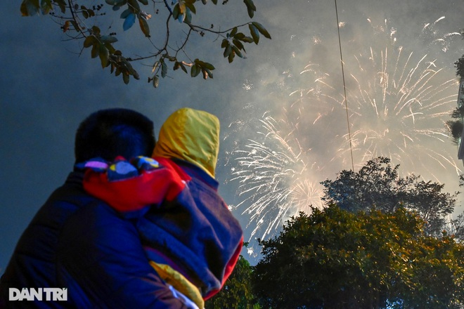 Watching fireworks at the night of 30th Tet - a quiet New Year's Eve minute in Hanoi - 11