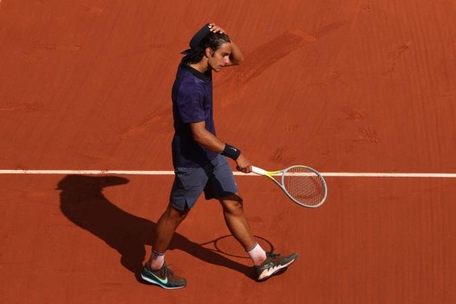 Sao trẻ người Italia bỏ cuộc, Djokovic giành vé vào tứ kết - 3