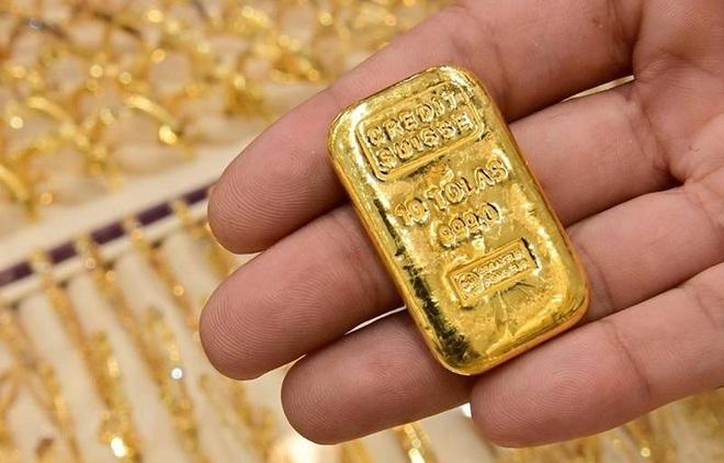 Giá vàng bốc hơi 100 USD/ounce sau quyết định của Fed - 1