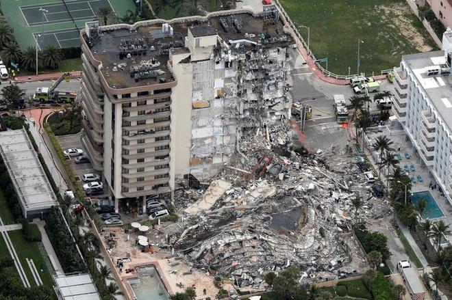 Lầu Năm Góc bác tin vụ nổ cạnh tàu sân bay gây sập chung cư - 1