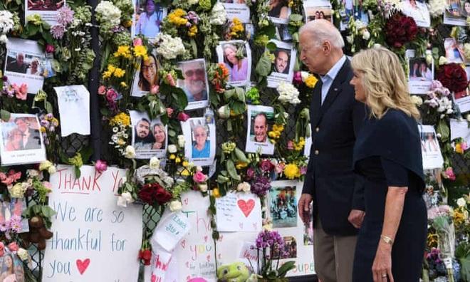 Ông Biden: Vẫn có thể tìm thấy người sống sót trong vụ sập chung cư 12 tầng - 1