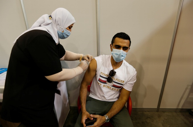 Nhiều nước cho phép tiêm trộn vắc xin Covid-19 - 2