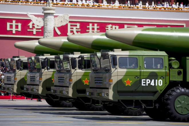 Kẹt giữa Mỹ và Trung Quốc, châu Á chạy đua phát triển hỏa lực - 1