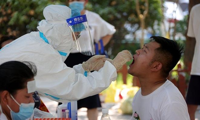 Trung Quốc phát hiện ổ dịch Covid-19 mới - 1
