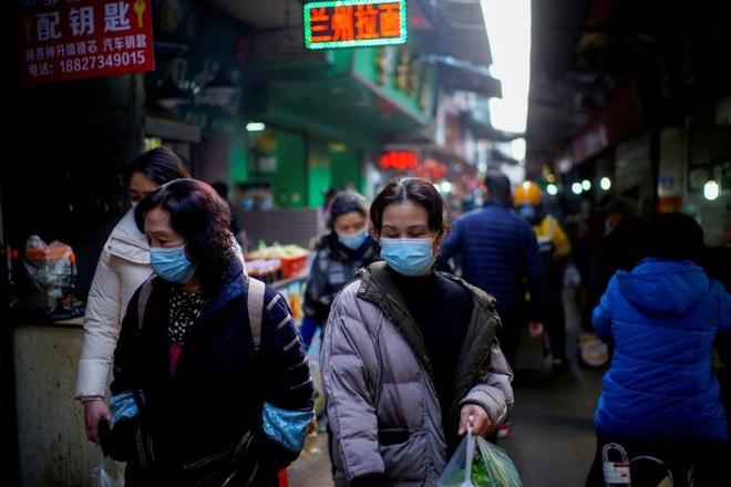Covid-19 trở lại, Trung Quốc xét nghiệm cho 11 triệu dân Vũ Hán - 1