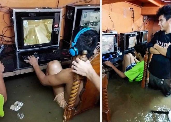 Bật cười hình ảnh các game thủ thản nhiên ngồi cày dù nước lụt bao quanh - 2