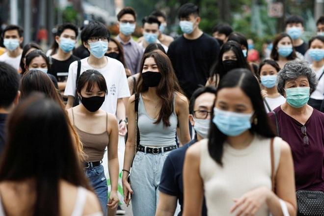Tiêm chủng 70% dân số, Singapore nới lỏng các hạn chế về Covid-19 - 1