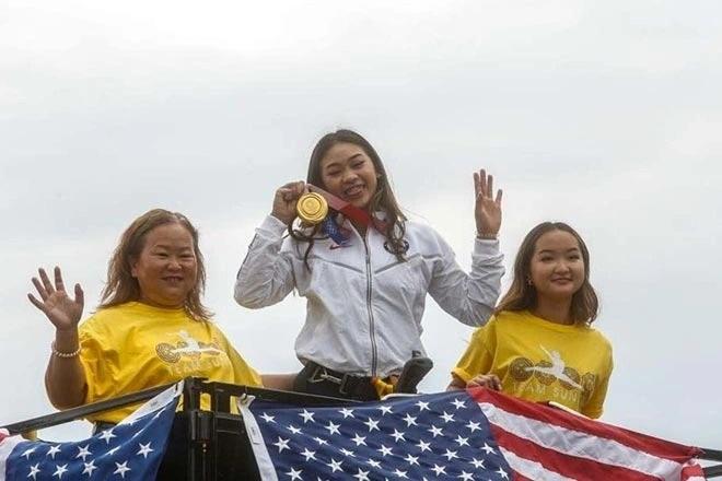 Cô gái HMông giành HCV Olympic 2020 được tiếp đón đặc biệt - 1