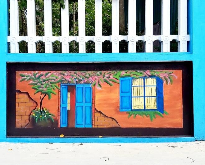 Mẹ đảm ở Vĩnh Phúc biến tường rào cũ kỹ thành loạt tranh vẽ sinh động - 5