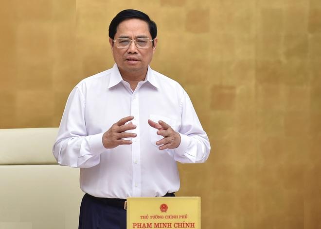 Thủ tướng yêu cầu làm rõ thông tin nâng giá kit xét nghiệm Covid-19 - 1
