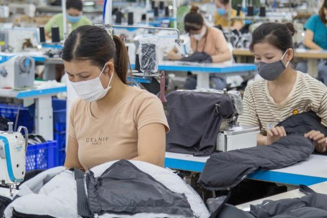 Hơn 80% công nhân đồng ý làm thêm vượt trần 40 giờ/tháng - 1