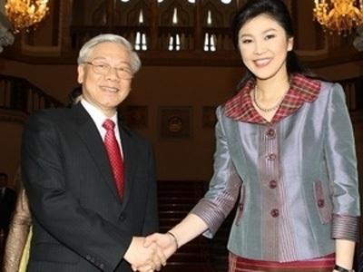 Tổng Bí thư Nguyễn Phú Trọng và Thủ tướng Thái Lan Yingluck Shinawatra. (Ảnh: Trí Dũng/TTXVN)