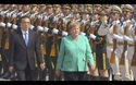Thủ tướng Đức ngồi ghế trong lễ đón chính thức tại Trung Quốc