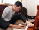 Viết bài thi bằng chân, nam sinh không tay thừa điểm vào đại học
