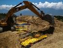 4 ngày sau thảm họa kép: Indonesia chôn tập thể các nạn nhân hàng ngày