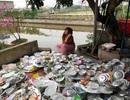 """""""Nữ giám đốc 8x rửa bát đĩa kín một sân ngày Tết"""" gây tranh cãi mạng xã hội"""