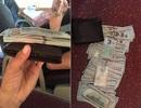 Tài xế xe khách trả lại 8.300 USD nhặt được trên xe