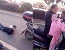 Phẫn nộ cảnh bà mẹ Trung Quốc kéo lê con trên đường