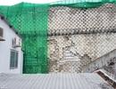 """Sau nhiều tranh cãi, bức tường """"khủng"""" đe dọa nhà dân ở Nha Trang đã tháo xong"""